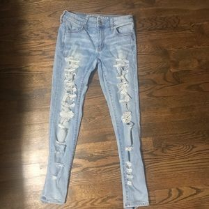 Distressed light wash american eagle jeans
